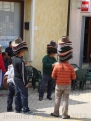 A couple of men selling hats.