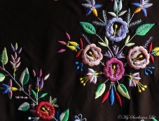 Colourful woven detail on a traditional head scarf